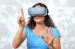 Woman experiencing a virtual environment royalty free stock images