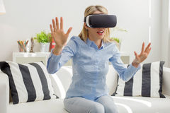 Woman experiencing virtual reality. In living room stock photos