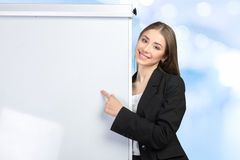 Woman explain at the whiteboard Royalty Free Stock Image