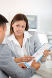 Woman explaining project to banker Royalty Free Stock Image
