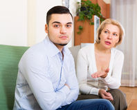 Woman explaining something to man Stock Photos
