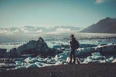Woman explorer lookig at Jokulsarlon lagoon, Iceland. Woman explorer lookig at Jokulsarlon lagoon, Iceland Royalty Free Stock Image
