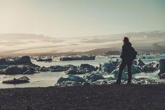 Woman explorer lookig at Jokulsarlon lagoon, Iceland. Woman explorer lookig at Jokulsarlon lagoon, Iceland Stock Photo