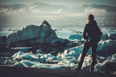 Woman explorer lookig at Jokulsarlon lagoon, Iceland. Royalty Free Stock Photo