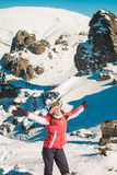 Woman explorer skier in mountains with snowy rocky background Stock Photography