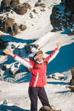Woman explorer skier in mountains with snowy rocky background Royalty Free Stock Images