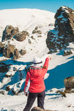 Woman explorer skier in mountains with snowy rocky background Royalty Free Stock Photo