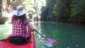 Woman Exploring Beautiful Lagoon On Kayak Boat Action Camera POV Of Girl Paddling. Back Rear View stock video footage