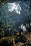Woman exploring a cave stock images