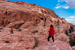 Woman exploring the colorful rocks of stone desert in Nevada, US Royalty Free Stock Photography