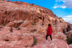 Woman exploring the colorful rocks of stone desert in Nevada, US Stock Photos
