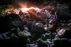 Woman Exploring Dewdrop Cave Craters of the moon National Idaho Stock Image