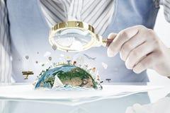 Woman exploring Earth planet . Mixed media Royalty Free Stock Image