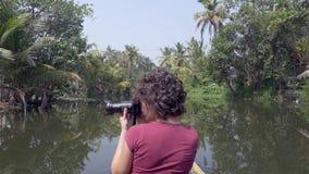Woman exploring kerala backwaters by canoe stock video footage