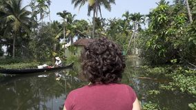 Woman exploring kerala backwaters by canoe stock footage