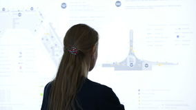 Woman exploring schematic map at the airport or stock video