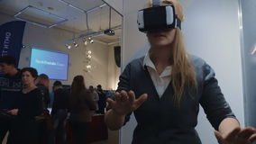 Woman Exploring Virtual Reality at Tech Ehxibition stock video footage