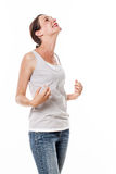 Woman expressing delight and pleasure looking up for satisfaction Stock Photo