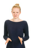 Woman expressing emotion of bad smell. Woman shows negative sign. Emotional on white background royalty free stock photo