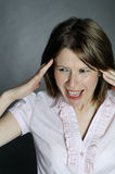 Woman expressing headache Royalty Free Stock Images