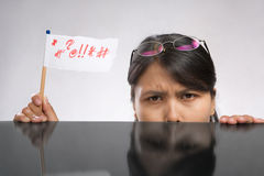 Woman expressing her angry with flag Royalty Free Stock Photos