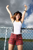 Woman expressing joy. Joyful young woman with her arms extended upward Royalty Free Stock Image