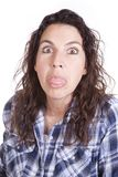 Woman expression blue tongue out. Royalty Free Stock Photos