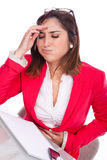 Woman expression of pain and discomfort at work. Woman beautiful expression of pain and discomfort at work Royalty Free Stock Photography