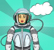 Woman with expression of surprise on her face in cosmonaut suit and speech bubble for your design, pop art style. Royalty Free Stock Image