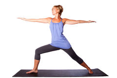 Woman extending arms in yoga. Warrior Two Virabhadrasana yoga pose extending arms by beautiful healthy woman, on white Stock Photo