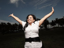 Woman extending her arms Royalty Free Stock Photos