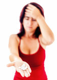 Woman extending her hand full of pills stock images