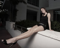 Woman extending her long legs Royalty Free Stock Images