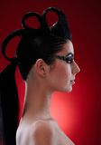 Woman with extravagant makeup and hairstyle Stock Photos