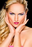 Woman with extravagant makeup. Retouched Royalty Free Stock Photography