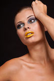 Woman with extreme colorfull make up in blue and yellow Royalty Free Stock Image