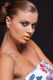 Woman with extreme colorfull make up in blue and yellow Stock Photo