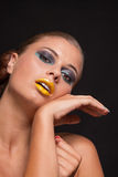 Woman with extreme colorfull make up in blue and yellow Stock Photos