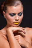 Woman with extreme colorfull make up in blue and yellow Royalty Free Stock Photography
