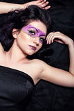 Woman with extreme glitter make-up in violet Royalty Free Stock Photos