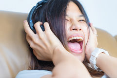 Woman is extremely excite by the Music. On her Headphone Royalty Free Stock Images