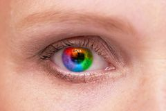 Woman eye. Macro shoot with rainbow pupil Stock Photo