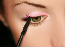 Woman eye. Woman applying make-up. Fashion royalty free stock photo