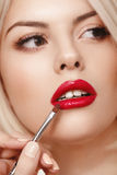 Woman Eye with Beautiful Makeup. Red Lips. Royalty Free Stock Photo