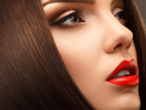 Woman Eye with Beautiful Makeup. Red Lips. High quality image.