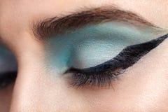 Woman eye with beautiful turquoise smokey eyes Royalty Free Stock Images