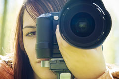 Woman eye behind camera Royalty Free Stock Photo