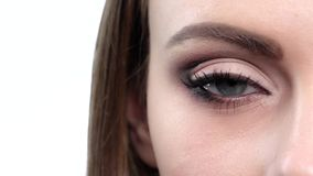 Woman eye with bright makeup. Close up. Slow motion