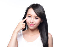 Woman eye care. Beautiful Woman show her health eye with smile face isolated on white background, asian beauty royalty free stock photography