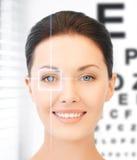 Woman and eye chart. Future technology, medicine and vision concept - woman and eye chart stock photo